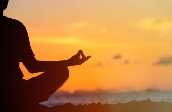 Serenity and yoga practicing at sunset, meditation
