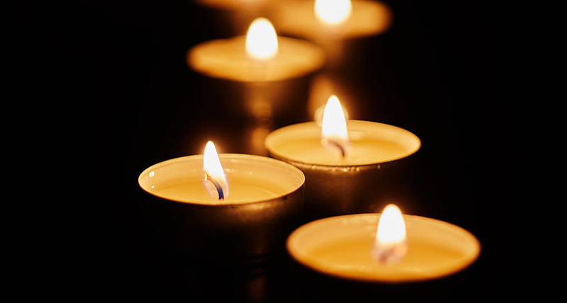 Burning votive candles on dark background - Jillian Frazin - Blessings of Jasmine